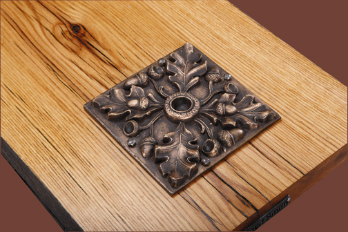 wrought-iron-oak-table-bronze-tile-closeup